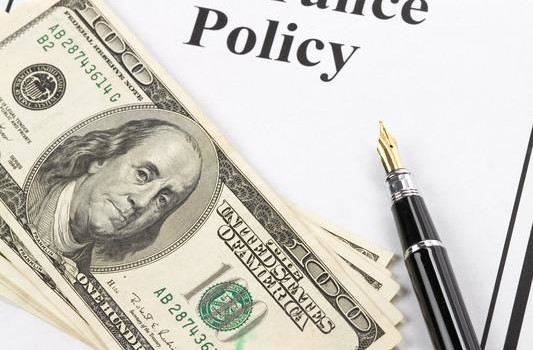 Insurance-Policy-and-Money-533x350